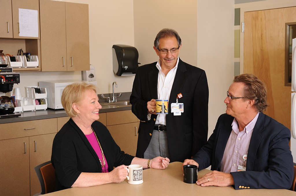 EastPointe Hospital's Administrator, Phil Cusa, meets with other staff members over coffee.