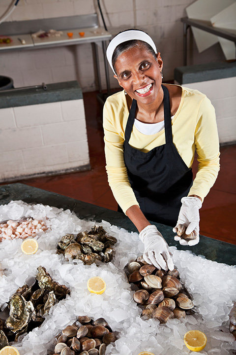 Woman working in seafood store
