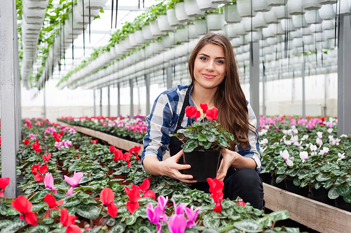 woman working in floral nursery