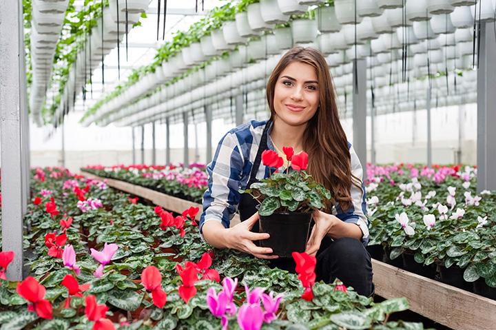 woman working in floral nursery